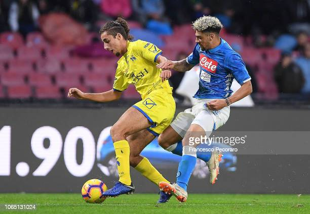 Kevin Malcuit of SSC Napoli vies Sofian Kiyine of Chievo Verona during the Serie A match between SSC Napoli and Chievo Verona at Stadio San Paolo on...