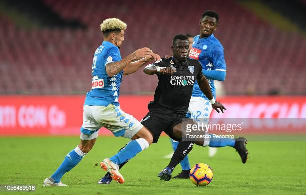 Kevin Malcuit of SSC Napoli vies with Afriyie Acquah of Empoli during the Serie A match between SSC Napoli and Empoli at Stadio San Paolo on November...