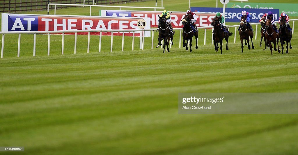 Kevin Manning riding Renaissance Art (L) win The Barronstown Stud EBF Maiden at Curragh racecourse on June 30, 2013 in Kildare, Ireland.