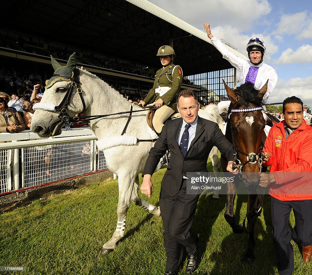 Kevin Manning riding Trading Leather win The Dubai Duty Free Irish Derby at Curragh racecourse on June 29, 2013 in Kildare, Ireland.