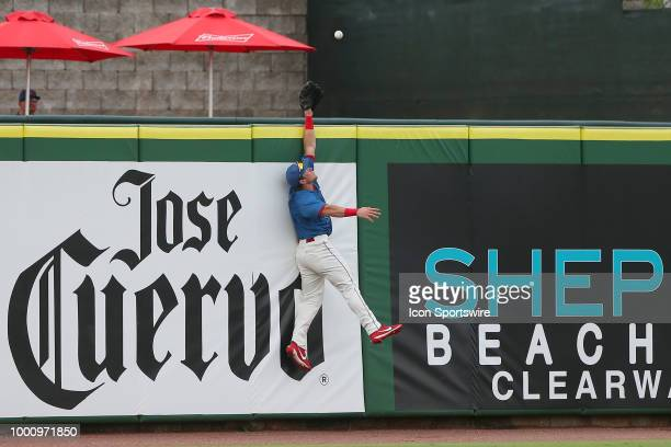 Kevin Markham of the Threshers goes up high to in hopes of making the home run robbing catch during the Florida State League game between the Daytona...
