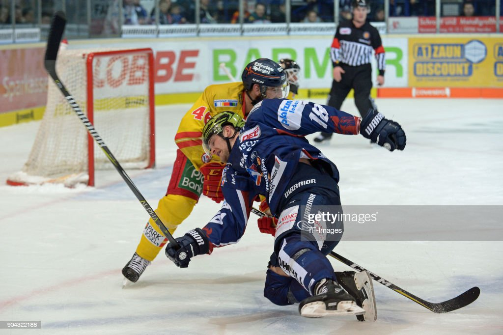 Kevin Marshall of Duesseldorf and Justin Florek of Iserlohn battle for the ball during the DEL match between Iserlohn Roosters and Duesseldorfer EG at Eissporthalle Iserlohn on January 12, 2018 in Iserlohn, Germany.