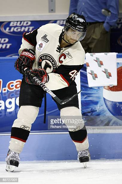 Kevin Marshall of the Quebec Remparts passes the puck during the warm up period prior to facing the Cape Breton Screaming Eagles at the Colisee Pepsi...