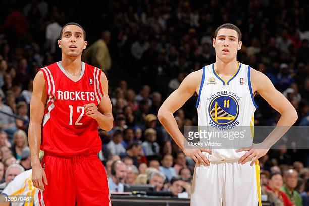 Kevin Martin of the Houston Rockets and Klay Thompson of the Golden State Warriors play in a game on February 12 2012 at Oracle Arena in Oakland...