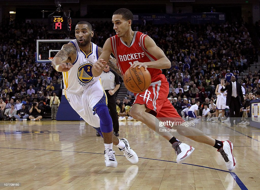 Kevin Martin #12 of the Houston Rockets dribbles past Acie Law #2 of the Golden State Warriors at Oracle Arena on December 20, 2010 in Oakland, California.