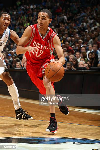 Kevin Martin of the Houston Rockets drives against Wesley Johnson of the Minnesota Timberwolves during the game on April 13 2011 at Target Center in...