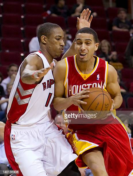 Kevin Martin of the Houston Rockets drives by DeMar DeRozan of the Toronto Raptors on Tuesday February 28 in Houston Texas