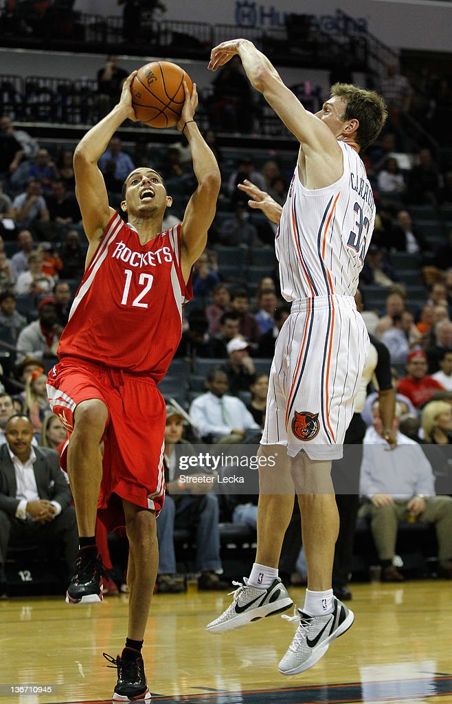 Kevin Martin #12 of the Houston Rockets drives past Matt Carroll #33 of the Charlotte Bobcats during their game at Time Warner Cable Arena on January 10, 2012 in Charlotte, North Carolina.