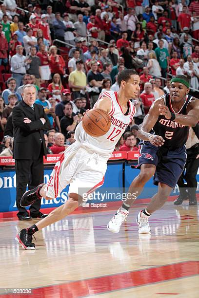 Kevin Martin of the Houston Rockets drives the ball past Joe Johnson of the Atlanta Hawks on April 3 2011 at the Toyota Center in Houston Texas NOTE...