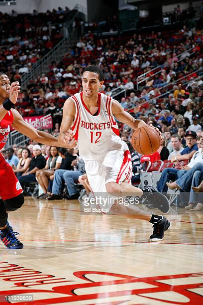Kevin Martin of the Houston Rockets drives the basket past Eric Gordon of the Los Angeles Clippers on April 9 2011 at the Toyota Center in Houston...