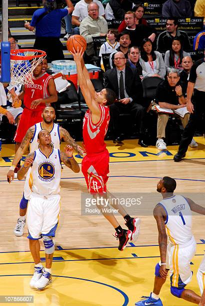 Kevin Martin of the Houston Rockets dunks against Monta Ellis of the Golden State Warriors on December 20 2010 at Oracle Arena in Oakland California...