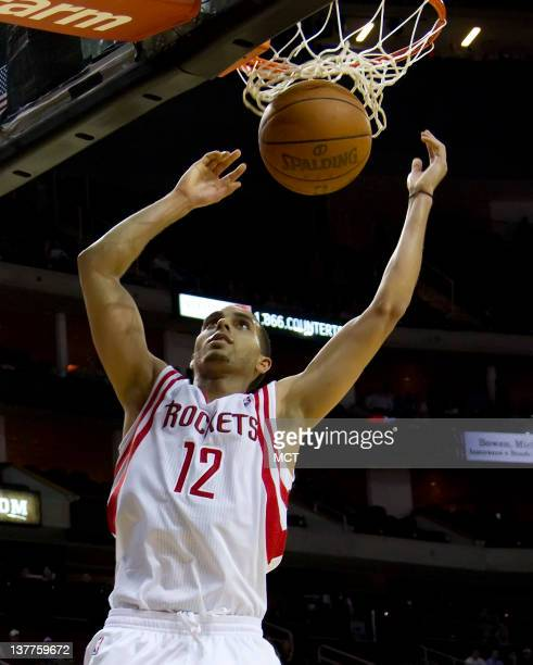 Kevin Martin of the Houston Rockets dunks for two of his 29 points against the Milwaukee Bucks in the second half of the Bucks' 10599 victory on...
