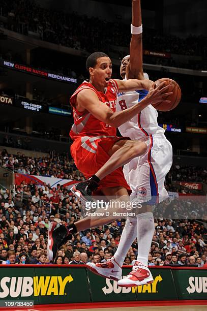 Kevin Martin of the Houston Rockets looks to make a pass against Jamario Moon of the Los Angeles Clippers at Staples Center on March 2 2011 in Los...