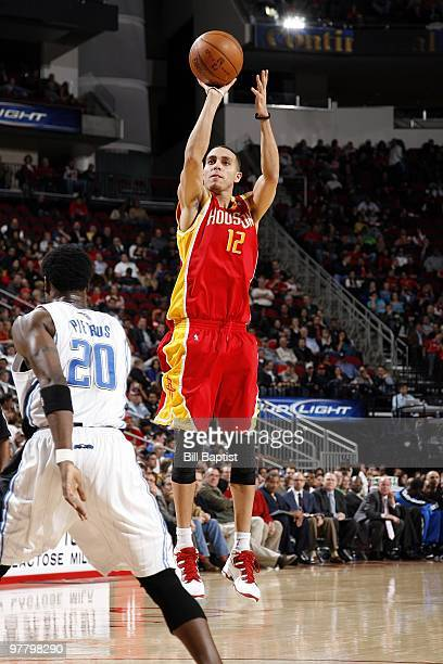 Kevin Martin of the Houston Rockets shoots a jump shot against Mickael Pietrus of the Orlando Magic during the game at Toyota Center on February 24...