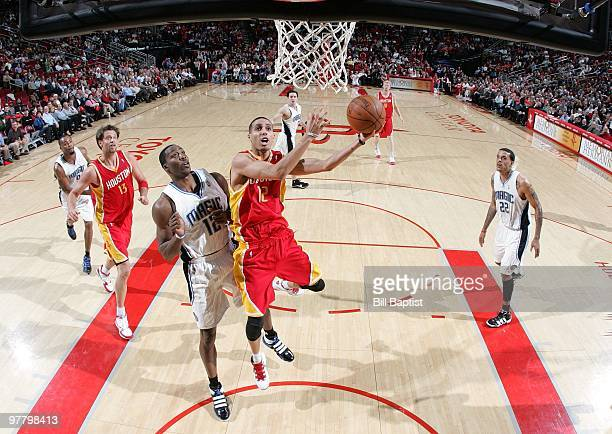 Kevin Martin of the Houston Rockets shoots a layup against Dwight Howard of the Orlando Magic during the game at Toyota Center on February 24 2010 in...