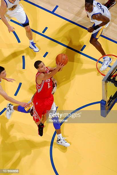 Kevin Martin of the Houston Rockets shoots against Acie Law of the Golden State Warriors on December 20 2010 at Oracle Arena in Oakland California...