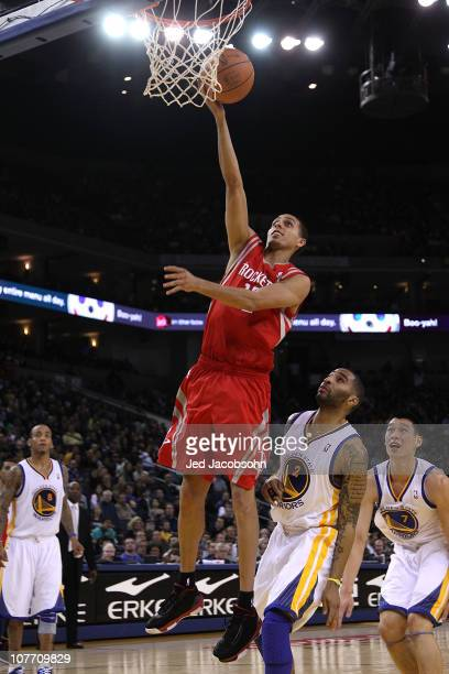 Kevin Martin of the Houston Rockets shoots over Acie Law of the Golden State Warriors during an NBA game at Oracle Arena on December 20 2010 in...