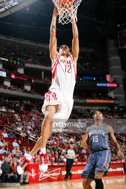 Kevin Martin of the Houston Rockets shoots the ball over Gerald Henderson of the Charlotte Bobcats on March 16 2011 at the Toyota Center in Houston...