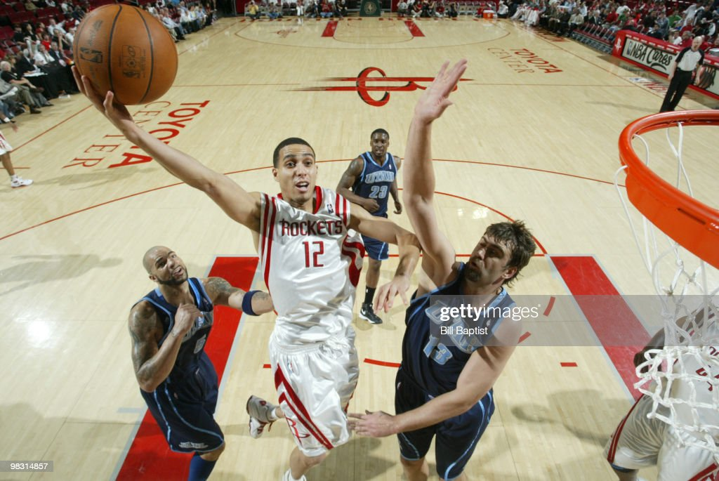 Kevin Martin #12 of the Houston Rockets shoots the ball over Mehmet Okur #13 of the Utah Jazz on April 7, 2010 at the Toyota Center in Houston, Texas.