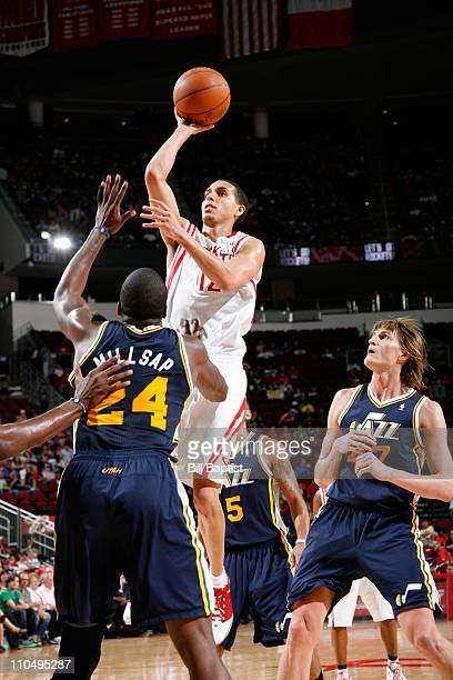 Kevin Martin of the Houston Rockets shoots the ball over Paul Millsap of the Utah Jazz on March 20 2011 at the Toyota Center in Houston Texas NOTE TO...