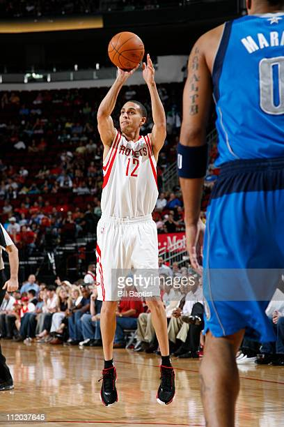 Kevin Martin of the Houston Rockets shoots the ball over Shawn Marion of the Dallas Mavericks on April 11 2011 at the Toyota Center in Houston Texas...