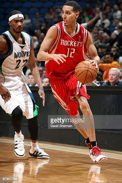 Kevin Martin of the Minnesota Timberwolves drives the ball up court past Corey Brewer of the Houston Rockets during the game at Target Center on...