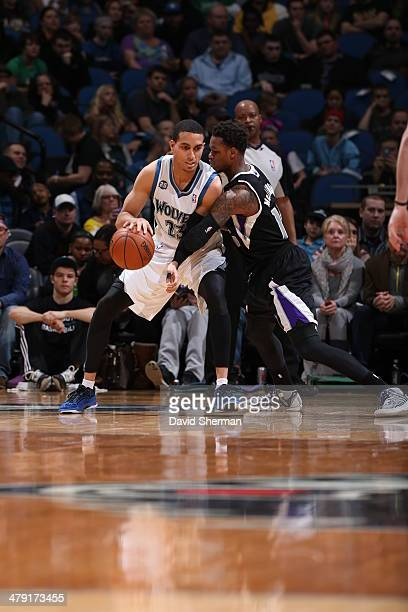 Kevin Martin of the Minnesota Timberwolves handles the ball against Ben McLemore of the Sacramento Kings on March 16 2014 at Target Center in...