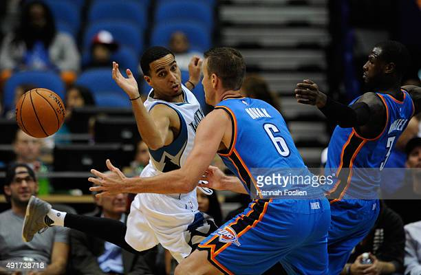 Kevin Martin of the Minnesota Timberwolves looses control ball against Steve Novak and Dion Waiters of the Oklahoma City Thunder during the first...