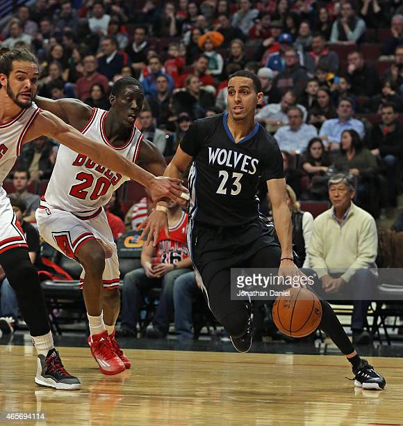 Kevin Martin of the Minnesota Timberwolves moves around Joakim Noah and Tony Snell of the Chicago Bulls at the United Center on February 27 2015 in...