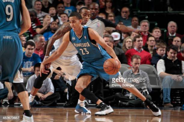 Kevin Martin of the Minnesota Timberwolves posts up against Monta Ellis of the Dallas Mavericks on November 30 2013 at the American Airlines Center...