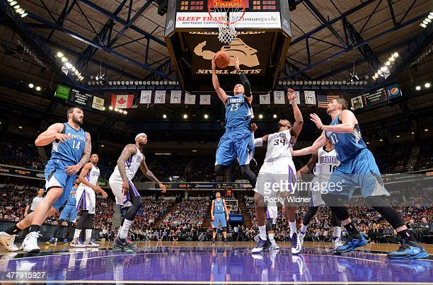 Kevin Martin of the Minnesota Timberwolves shoots a layup against Jason Thompson of the Sacramento Kings on March 1 2014 at Sleep Train Arena in...