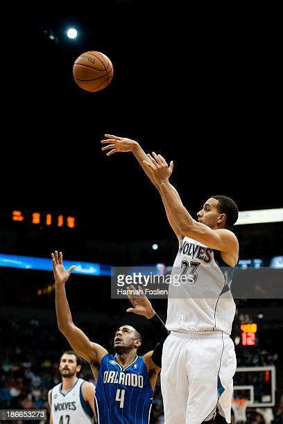 Kevin Martin of the Minnesota Timberwolves shoots the ball against Arron Afflalo of the Orlando Magic during the game on October 30 2013 at Target...