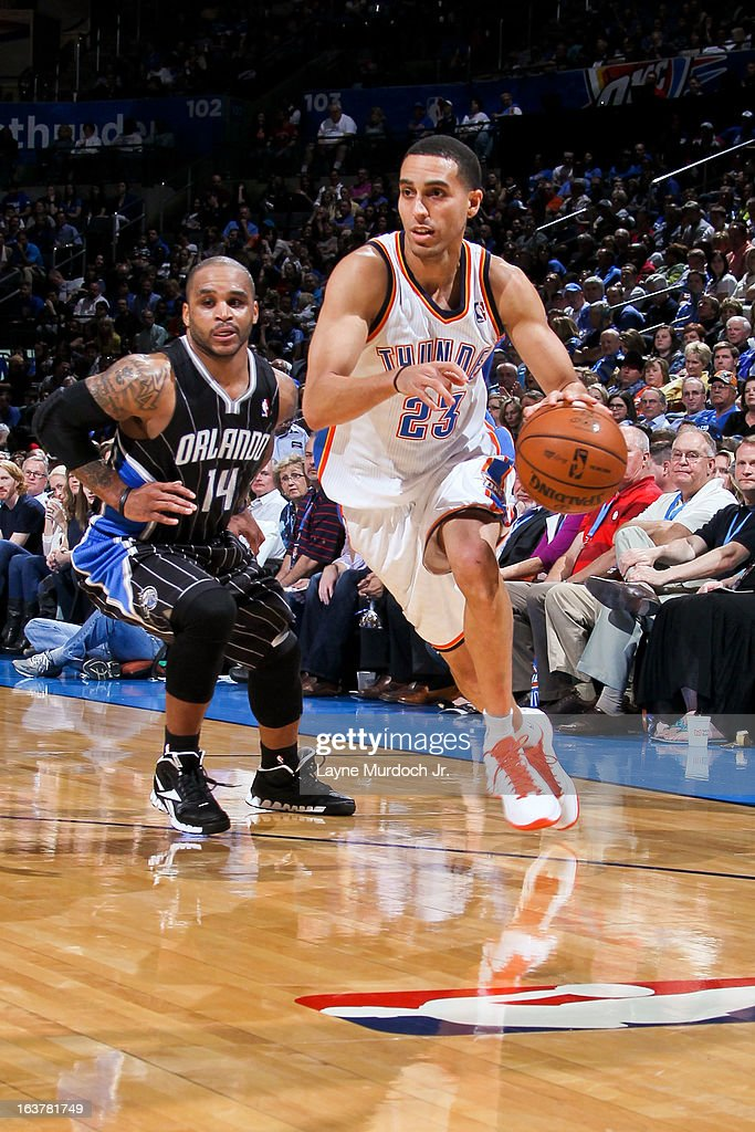Kevin Martin #23 of the Oklahoma City Thunder drives against Jameer Nelson #14 of the Orlando Magic on March 15, 2013 at the Chesapeake Energy Arena in Oklahoma City, Oklahoma.