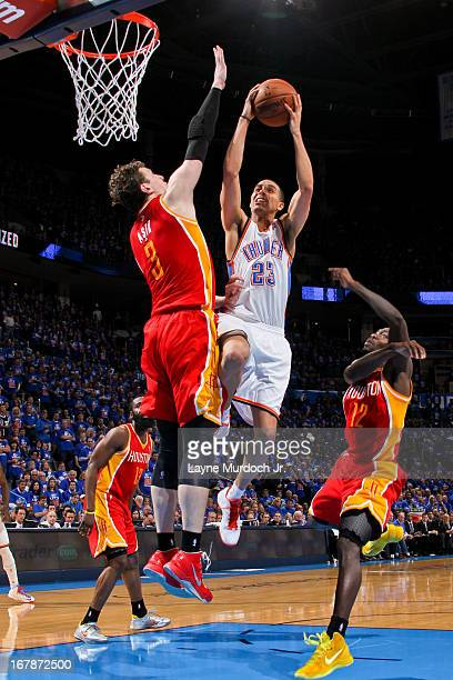 Kevin Martin of the Oklahoma City Thunder drives to the basket against Omer Asik of the Houston Rockets in Game Five of the Western Conference...