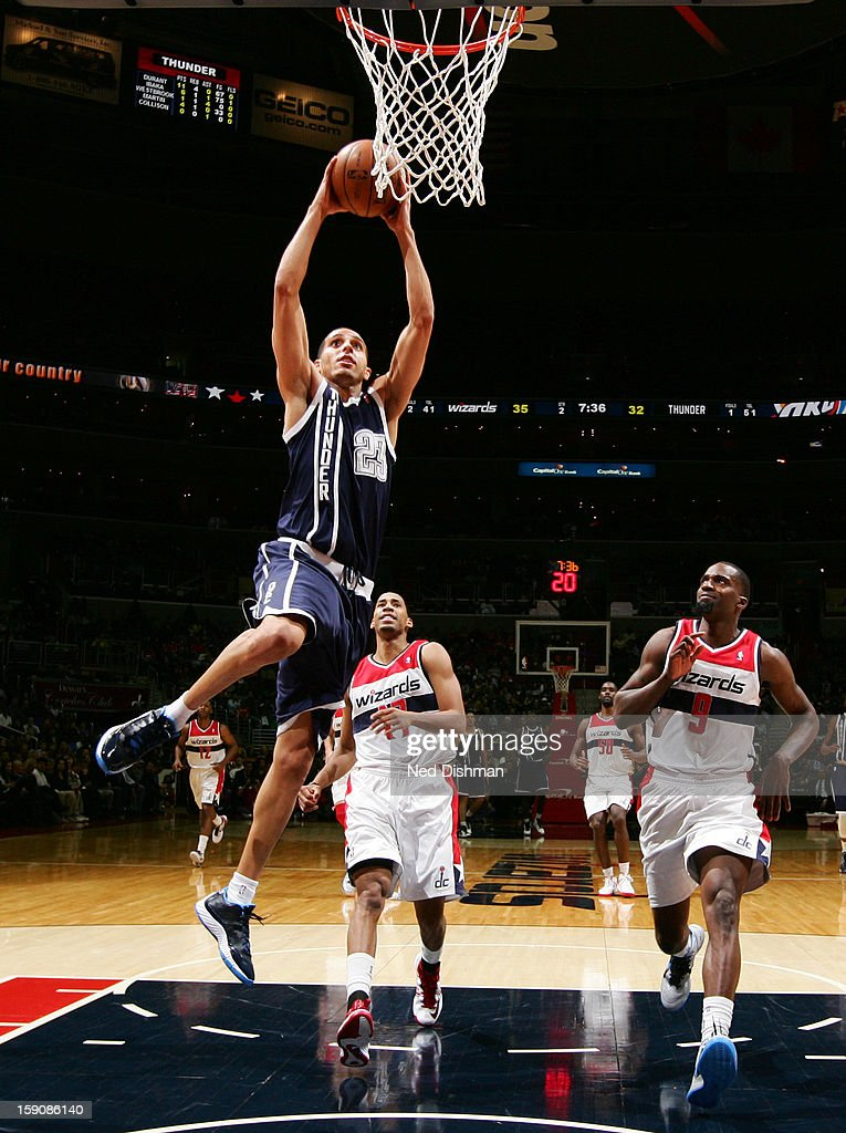 Kevin Martin #23 of the Oklahoma City Thunder rises for a dunk against Garrett Temple #17 and Martell Webster #9 of the Washington Wizards during the game at the Verizon Center on January 7, 2013 in Washington, DC.