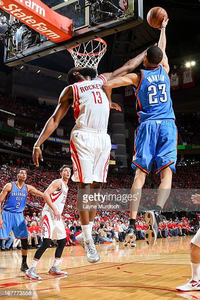 Kevin Martin of the Oklahoma City Thunder shoots a layup against James Harden of the Houston Rockets in Game Four of the Western Conference...