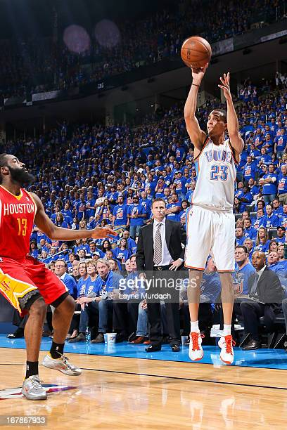 Kevin Martin of the Oklahoma City Thunder shoots a threepointer against James Harden of the Houston Rockets in Game Five of the Western Conference...