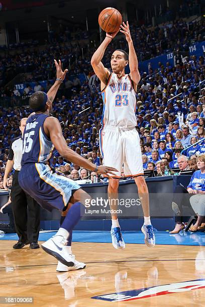 Kevin Martin of the Oklahoma City Thunder shoots a threepointer against Keyon Dooling of the Memphis Grizzlies in Game One of the Western Conference...