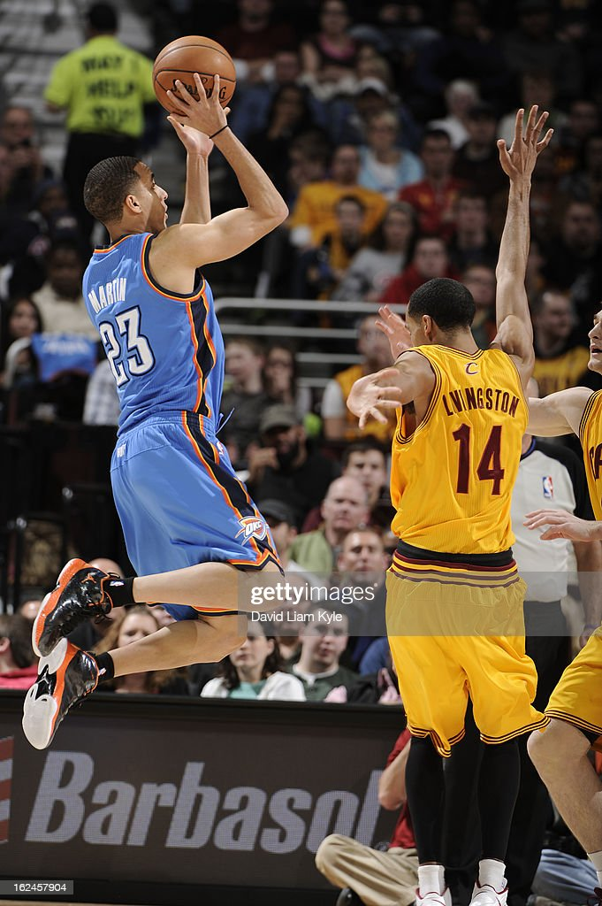 Kevin Martin #23 of the Oklahoma City Thunder takes a shot against Shaun Livingston #14 of the Cleveland Cavaliers at The Quicken Loans Arena on February 2, 2013in Cleveland, Ohio.