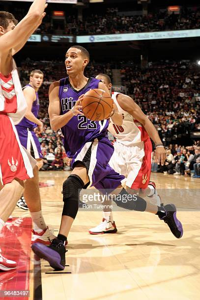 Kevin Martin of the Sacramento Kings drives hard to the basket defended by Andrea Bargnani of the Toronto Raptors during a game February 7 2010 at...