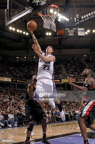 Kevin Martin of the Sacramento Kings drives to the basket around Zach Randolph of the Portland Trailblazers on December 26 2005 at the ARCO Arena in...