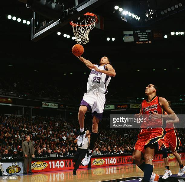 Kevin Martin of the Sacramento Kings elevates to the basket for a dunk against Matt Barnes of the Golden State Warriors at Arco Arena on December 30...