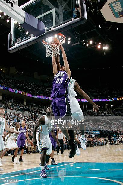Kevin Martin of the Sacramento Kings goes to the basket past Desmond Mason of the New Orleans/Oklahoma City Hornets during the game at the Ford...