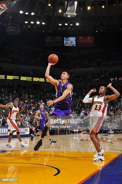 Kevin Martin of the Sacramento Kings goes up for a shot against CJ Watson of the Golden State Warriors during the game at Oracle Arena on January 14...