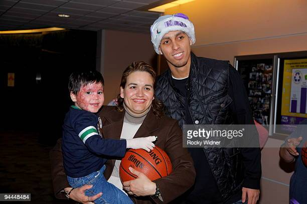 Kevin Martin of the Sacramento Kings poses for a photo with a family on December 13 2009 at Shriners Hospital for Children in Sacramento California...