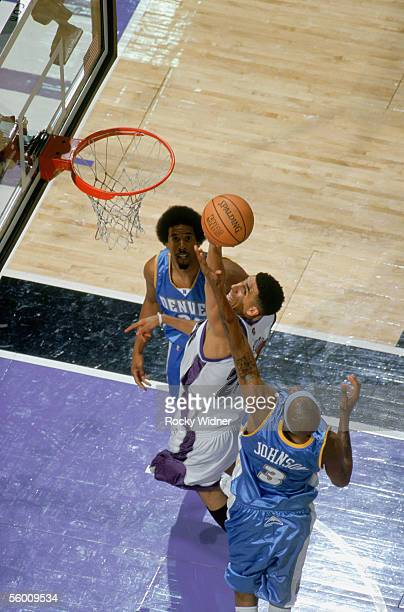 Kevin Martin of the Sacramento Kings reaches for the basket against Dermarr Johnson of the Denver Nuggets at Arco Arena on October 18 2005 in...