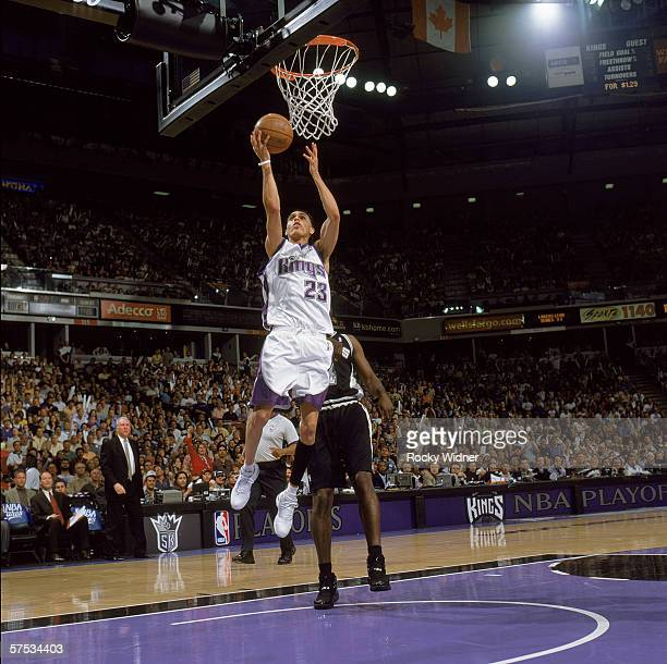 Kevin Martin of the Sacramento Kings reaches for the basket against Michael Finley of the San Antonio Spurs in game four of the Western Conference...