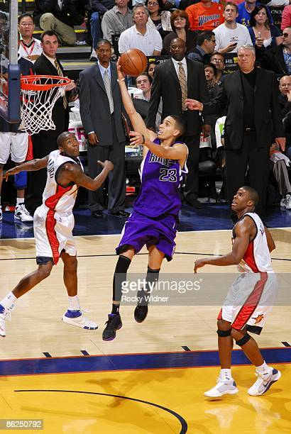 Kevin Martin of the Sacramento Kings shoots a layup against Jamal Crawford and Kelenna Azubuike of the Golden State Warriors during the game at...