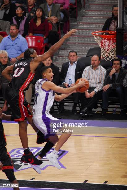 Kevin Martin of the Sacramento Kings takes the ball to the basket against Udonis Haslem of the Miami Heat on December 7 2006 at ARCO Arena in...