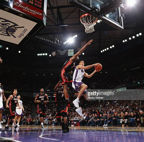 Kevin Martin of the Sacramento Kings takes the ball to the basket against Udonis Haslem of the Miami Heat during a game at Arco Arena on December 7...